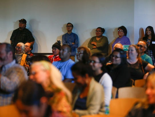 Audience members listen during a speaking engagement by poet Luci Tapahonso Thursday at the Farmington Public Library.