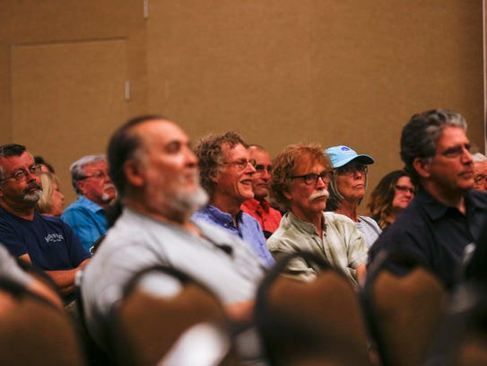 Community members listen to a presentation during an Outdoor Recreation Industry Initiative meeting Thursday at the Farmington Civic Center.