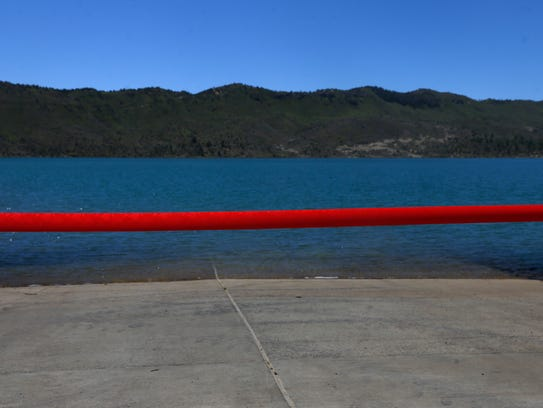 A red ribbon stretches across the boat launch for a ribbon cutting ceremony Monday at Lake Nighthorse in Durango, Colorado.