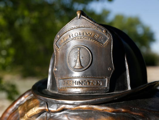 A memorial for Farmington Fire Department Lt. Jacob Shadd Rohwer is displayed Thursday in Animas Park in Farmington.