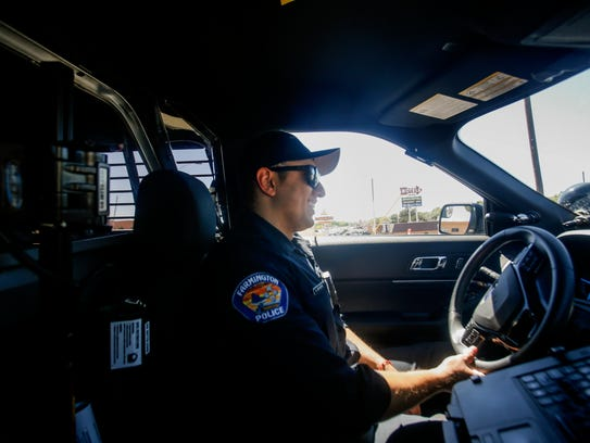 Farmington police Officer Alvin Bencomo drives his patrol unit Friday in Farmington.