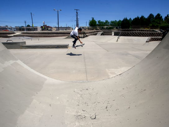 A skateboarder rides his board Tuesday at the Brookside Skate Park in Farmington.