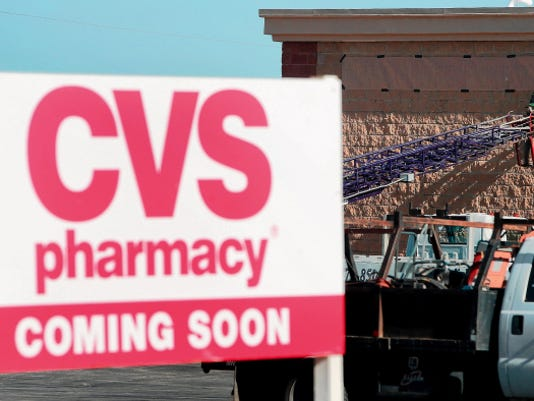 A workman carries building material last week past the entrance of the new CVS/pharmacy store at Joe Battle and Edgemere boulevards. A worker last week prepared a template for a new CVS/pharmacy sign on the exterior of the new drugstore at Joe Battle and Edgemere in East El Paso. It's the chain's fourth El Paso store, with plans for more El Paso stores in the future.