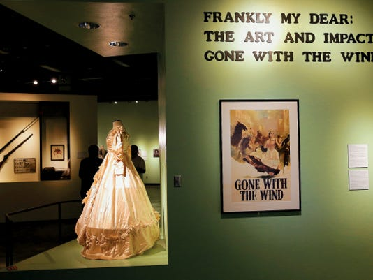 "The exhibit ""Frankly My Dear: The Art and Impact of Gone with the Wind"" featuring reproduction movie pieces including the official copy of Scarlett O'Hara's wedding dress, Civil War-era weapons, photographs and more from the movie ""Gone With the Wind,"" will open today at the El Paso Museum of History. The exhibit is tied to the Plaza Classic Film Festival."