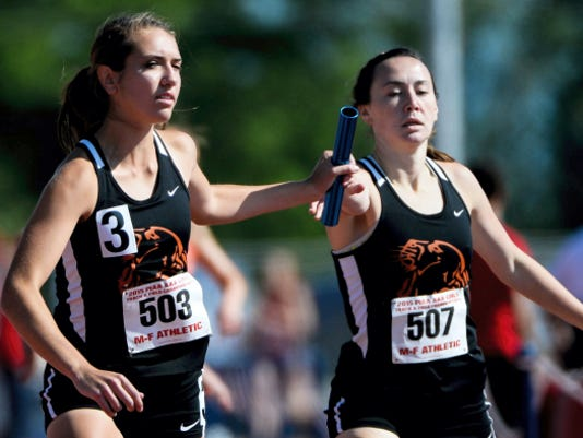 Palmyra's Maria Tukis hands the baton off to Katie Dembrowski during the girls AAA 4x800 relay trials on Friday at the PIAA Track and Field Championships on Friday at Shippensburg. Along with Jess Dembrowski and Miranda Salvo, the Cougars qualified for Saturday's state finals.