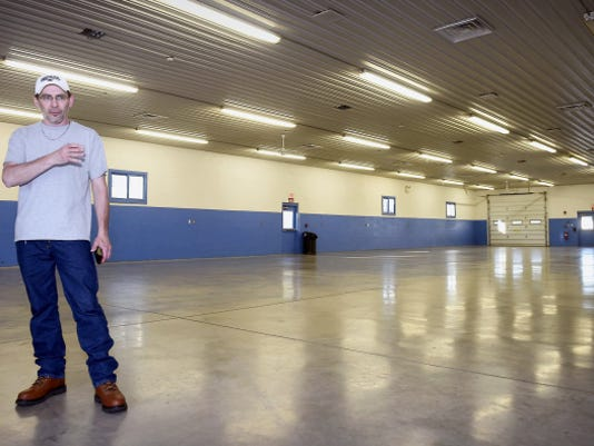 Dana Lape, chairman of the Poultry Show, is a lonely figure inside the poultry building at the Lebanon Area Fairgrounds. Avian flu fears will keep live birds from next month's exposition, but there'll still be a contest and voting — along with an opportunity to raise money to fight cancer, Lape said.