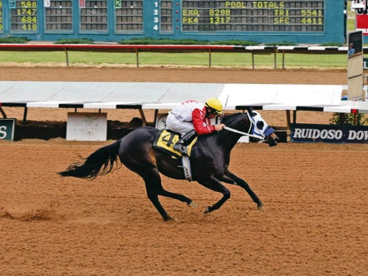 Lilly Is First wins the Mountain Top New Mexico-Bred Futurity at Ruidoso Downs.