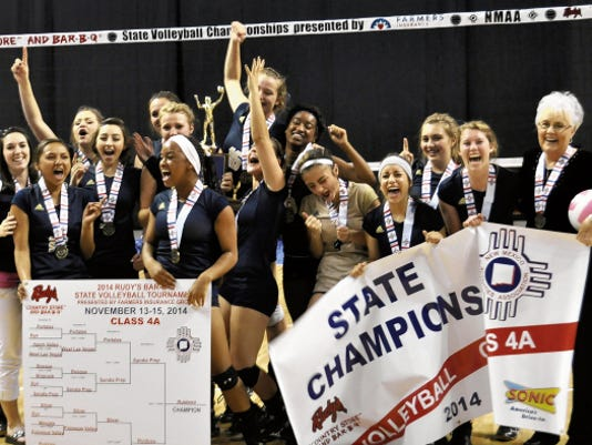 RHS volleyball coach Pam Allen, far right, is seen here with the Ruidoso Lady Warriors after they won the 2014 Class 4A volleyball state championship.
