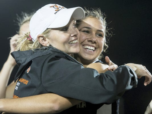 Palmyra's Erin Huffman gets a hug from head coach Kristi Costello after the Cougars defeated Boiling Springs, 2-1,  to win the Mid-Penn championship on Thursday night.