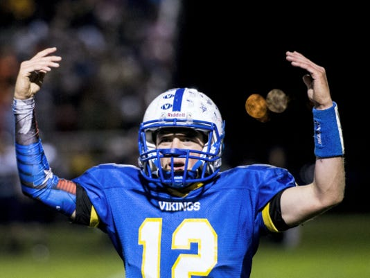 Northern Lebanon's Isaac Wengert pumps up the crowd after a Northern Lebanon touchdown during the Vikings' 44-41 win over Elco on Friday night.