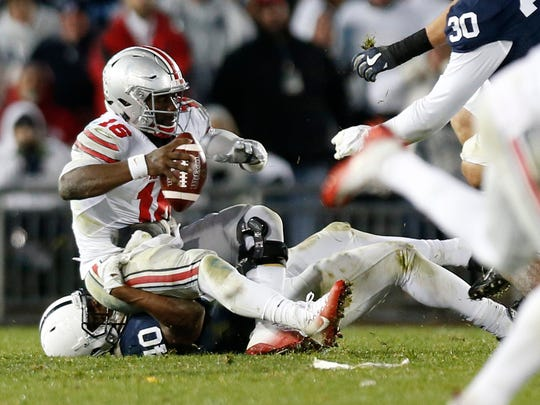 Ohio State quarterback J.T. Barrett (16) was sacked