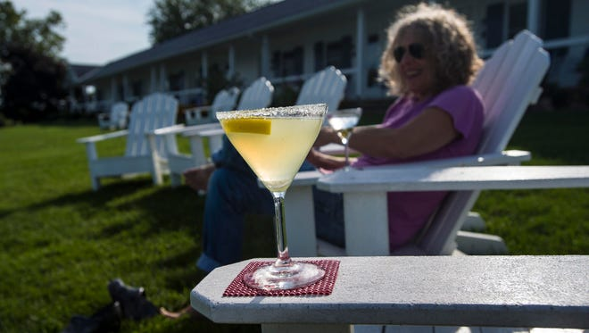 A lemondrop cocktail is enjoyed on the lawn behind Shore Acres Inn and Restaurant in North Hero on Grand Isle on Wednesday, August 17, 2016.