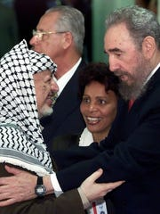 In this April 12, 2000, file photo, Cuba's leader Fidel Castro, right, greets Palestinian leader Yasser Arafat at the inauguration of the South Summit of developing nations in Havana.