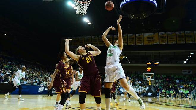 Notre Dame forward Natalie Achonwa (11) goes to the basket while being fouled by Arizona State forward Sophie Brunner (21) on March 24, 2014, in the first half of a women's college basketball game in the second round of the NCAA Tournament.