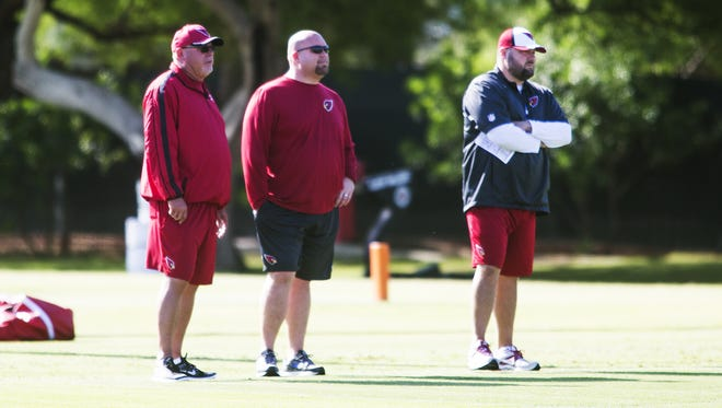 Arizona Cardinals' Bruce Arians (left) and Steve Keim  (right) watch practice in Tempe, Tuesday, May 19, 2015.