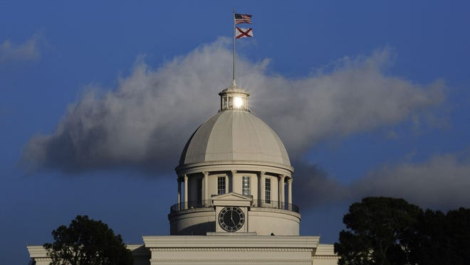 The sun reflects off of a window over the dome of the State capitol Building in downtown Montgomery.