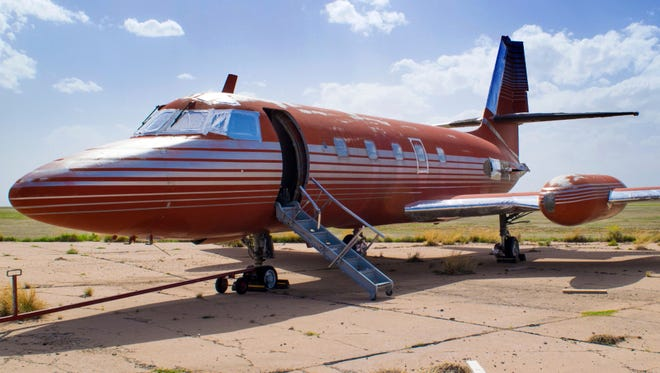 This undated photo provided by GWS Auctions, Inc. shows a private jet once owned by Elvis Presley, on a runway in New Mexico.