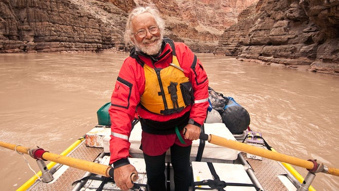 This 2010 photo provided by Northern Arizona University shows photographer John Running on the Colorado River. Running died   Jan. 7, 2018, of complications from a brain tumor at his Flagstaff home, said his daughter, Raechel Running. He was 77.