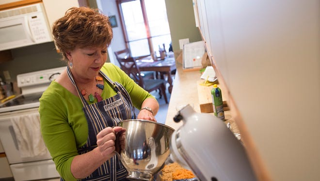 Lisa Boesen prepares a sweet potato pone at her home in south Fort Collins  on Monday. The dish has become a Thanksgiving tradition after her father was given a restrictive diet following heart surgery in 1999.