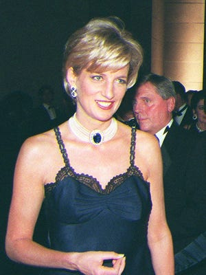 Princess Diana walks through the Metropolitan Museum of Art in New York.