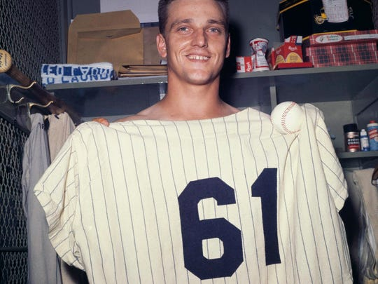 Yankees slugger Roger Maris poses at Yankee Stadium on the final day of the regular season, Oct. 1, 1961, with a jersey indicating he hit his 61st home run, breaking Babe Ruth's single-season record.