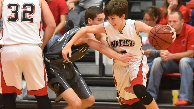 Norfork's Tyler Sorters tries to get around Izard County's Caleb Faulkner during the Panthers' 69-39 loss Friday night at Norfork.