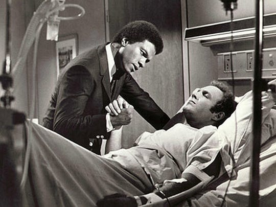 """Billy Dee Williams (left) and James Caan star in the 1971 TV movie """"Brian's Song."""""""