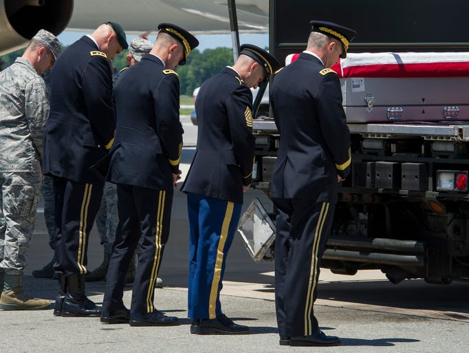 Army and Air Force Officers pray over the transfer