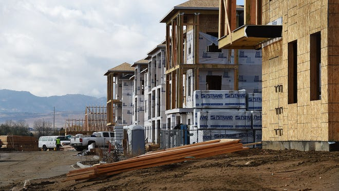 Construction continues at Crowne on Timberline apartments north of East Trilby Road.
