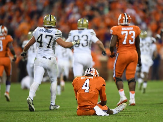 Clemson quarterback Deshaun Watson (4) sits on the field after throwing an interception to Pitt during the fourth quarter on Nov. 12 at Clemson's Memorial Stadium.