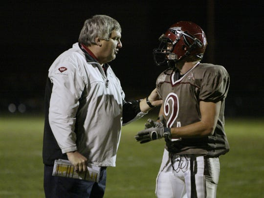FILE – Danville coach Terry Siddall talks to receiver K.C. Woods (2) in Class 3A Sectional 21 title game, Nov, 2, 2007. Woods was named Danville's coach on Monday.