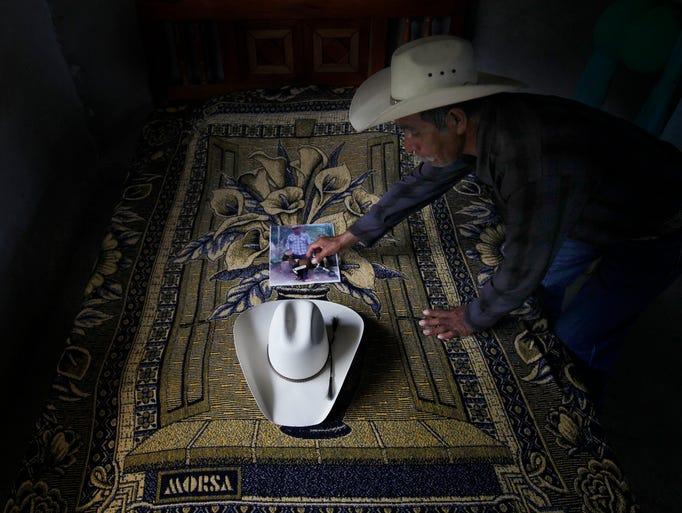 Wenceslao Rangel Gutierrez places a miniature horse