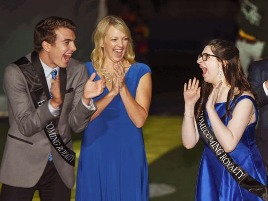 Riley McCoy, right, reacts to being named homecoming