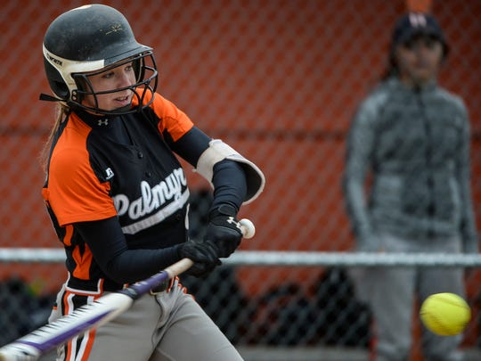 Palmyra's Kayla Bonawitz connects for one of her three hits in the Cougars' 13-3 defeat of Hershey on Wednesday.