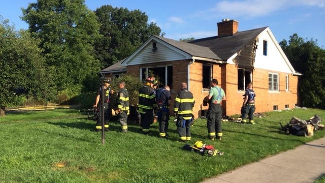 Firefighters at the scene of a fire in Irondequoit Wednesday.