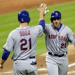 New York Mets' Daniel Murphy (28) is congratulated by teammate Lucas Duda (21), who scored after Murphy hit a three-run home run against the Miami Marlins in the ninth inning of a baseball game, Monday, April 27, 2015, in Miami. Juan Lagares also scored on the home run. The Mets won 3-1.