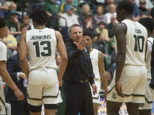 CSU coach Larry Eustachy gives instructions to the Rams as they huddle together for a time out in a game against Fresno State at Moby Arena on Jan. 6.