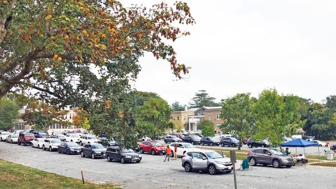 Hundreds of cars line up for the Barnstable County Health Department's mobile flu shot clinic last Saturday morning.