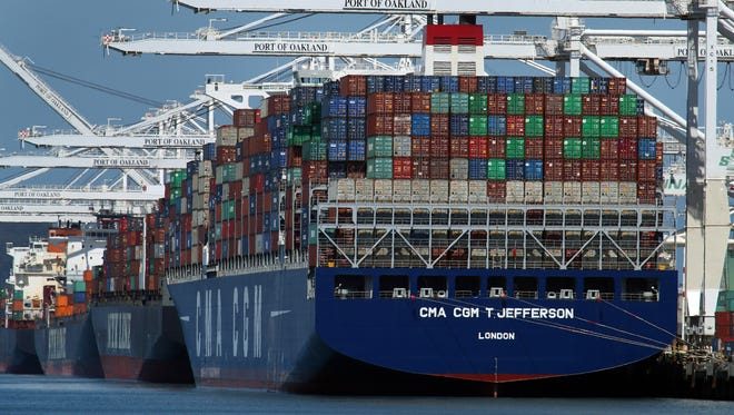 Container ships are unloaded at the Port of Oakland in Oakland, Calif. On Wednesday, May 30, the Commerce Department issues the second of three estimates of how the U.S. economy performed in the January-March quarter.
