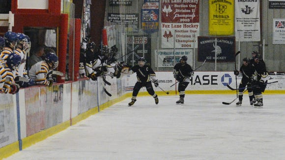 Riku Robins leads the celebration after scoring a first-period goal for Clarkstown on Friday at Brewster Ice Arena.