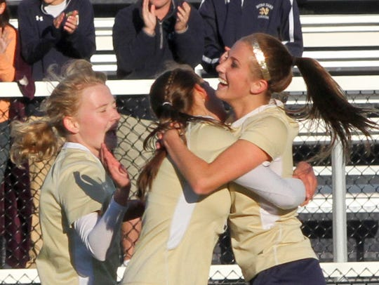 Notre Dame players celebrate after Reilly Edger, right,