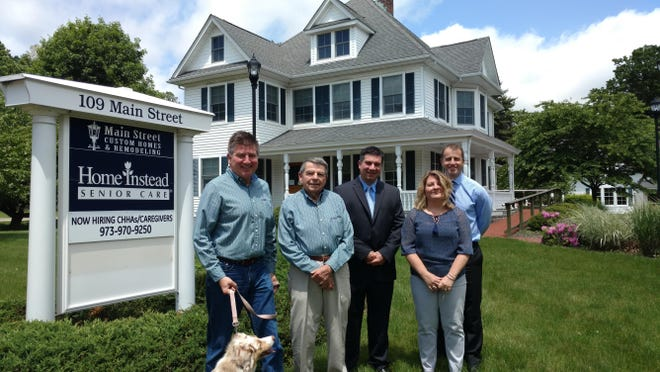Three businesses have found new homes in Roxbury. Pictured here from left to right are Donald Dyrness, owner of Main Street Custom Homes & Remodeling, Daniel Dyrness, supervisor/lead designer of Main Street Custom, Tom Seretis, broker/owner of Elite Real Estate Brokerage, Rebecca Rasmussen, senior branch office administrator of Edward Jones, Jonathan M. LeVar, financial advisor of Edward Jones.