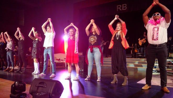 """Roger Bacon High School students performing """"Godspell."""""""