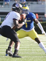 Delaware defensive back Malcolm Brown moves in on James Madison receiver Terrance Alls in the second quarter at Delaware Stadium.