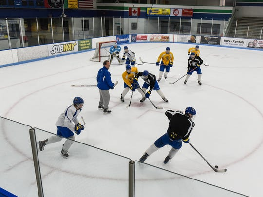 Cathedral players take part in a drill during practice Friday, Dec. 15, at the MAC in St. Cloud.
