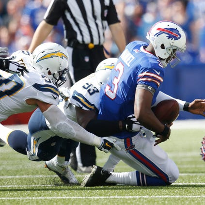 Buffalo Bills quarterback EJ Manuel (3) is sacked by San Diego Chargers outside linebacker Dwight Freeney (93) and inside linebacker Manti Te'o (50) during the second half at Ralph Wilson Stadium. Chargers beat the Bills 22-10.