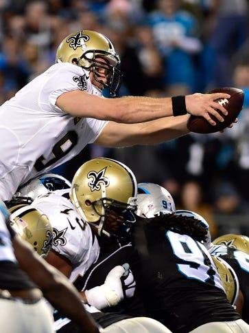 New Orleans Saints quarterback Drew Brees (9) scores