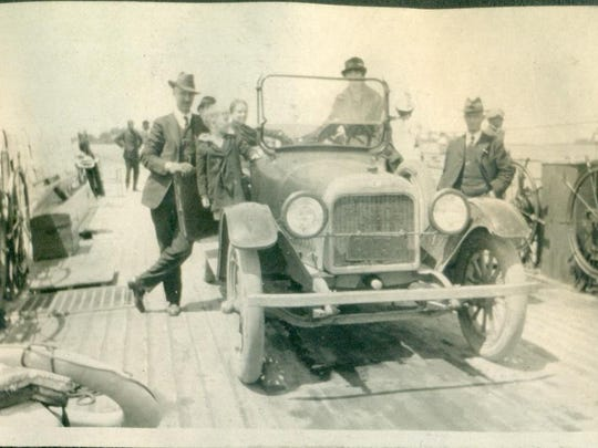 Edward Reeves, left, crossing Lake Champlain on the auto ferry.