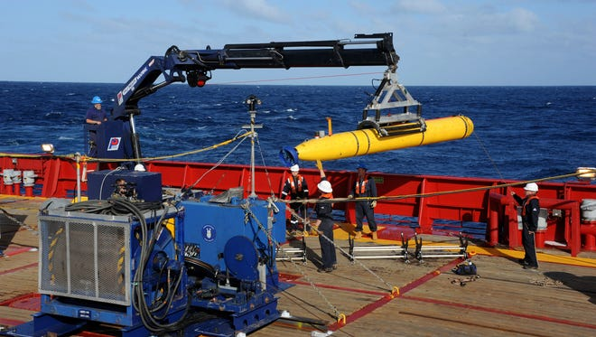 The Bluefin 21 autonomous sub is hoisted back on board the Australian Defense Vessel Ocean Shield in the Indian Ocean, as search efforts continue for missing Malaysia Airlines Flight 370.
