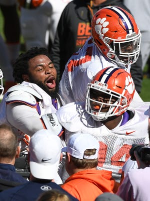 Clemson defensive lineman Josh Belk (94) celebrates with teammate defensive lineman Christian Wilkins (42) during a drill at the team's practice on Wednesday, April 4, 2018 at Clemson's Memorial Stadium.